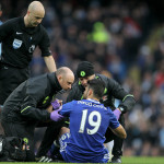 Chelsea's Diego Costa is treated for injury during the Premier League match at the Etihad Stadium, Manchester.