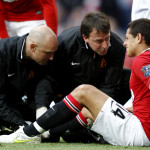 Manchester United's Javier Hernandez receives treatment from the physios after being fouled by Chelsea's Ashley Cole