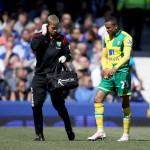 Norwich City's Martin Olsson leaves the pitch with an injury during the Barclays Premier League match at Goodison Park, Liverpool.
