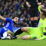Chelsea's Cesc Fabregas (left) and Peterborough United's Chris Forrester (right) battle for the ball
