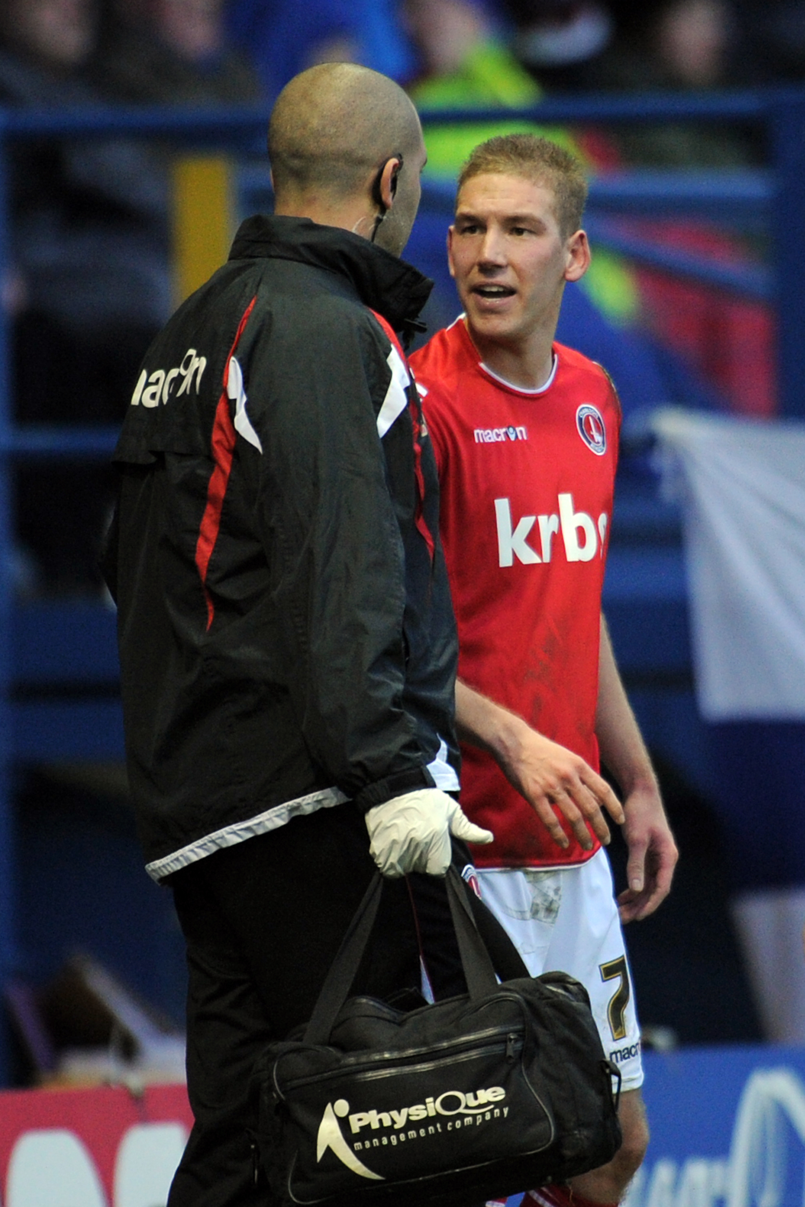 Charlton Athletic's Scott Wagstaff is tended to by head physiotherapist Erol Umut after taking a knock