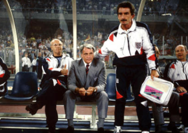 England coach Don Howe (left) and physiotherapist Norman Medhurst (right) console manager Bobby Robson (centre) as Chris Waddle misses the vital penalty to eliminate England from the World Cup