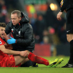 Liverpool's Adam Lallana receives treatment for an injury during the Premier League match at Anfield, Liverpool.