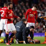 Hull City's Markus Henriksen lies injured after a tackle with Manchester United's Paul Pogba (not pictured) during the EFL Cup Semi Final, First Leg match at Old Trafford, Manchester.