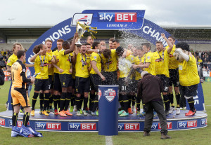 The Burton Albion team celebrate during the trophy presentation at the Pirelli Stadium, Burton Upon Trent. PRESS ASSOCIATION Photo. Picture date: Sunday May 3, 2015. See PA story SOCCER Burton. Photo credit should read: Clint Hughes/PA Wire. RESTRICTIONS: Editorial use only. Maximum 45 images during a match. No video emulation or promotion as 'live'. No use in games, competitions, merchandise, betting or single club/player services. No use with unofficial audio, video, data, fixtures or club/league logos.